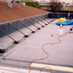 During / After: Retail Center Tapered Insulation System Roofing Job in Madison, WI